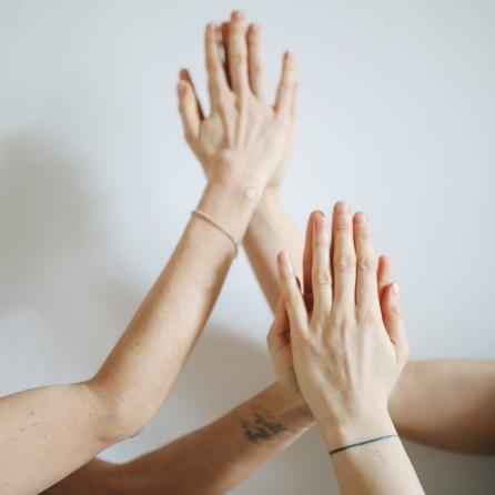 women-touching-hands-3735476
